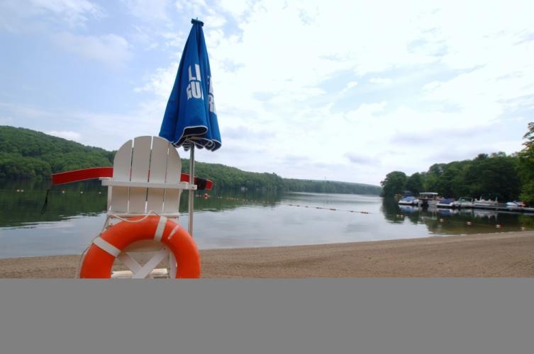 The calm waters during an early morning visit to Eichler's Cove in Sandy Hook belie the activity that will fill the beach and section of Lake Zoar once swimmers arrive. The beach and swimming area at the end of Old Bridge Road offer one of two…
