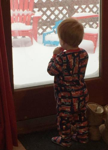 Little Grayson Engelke watches the storm with which he shares a name - Storm Grayson - on January 4.