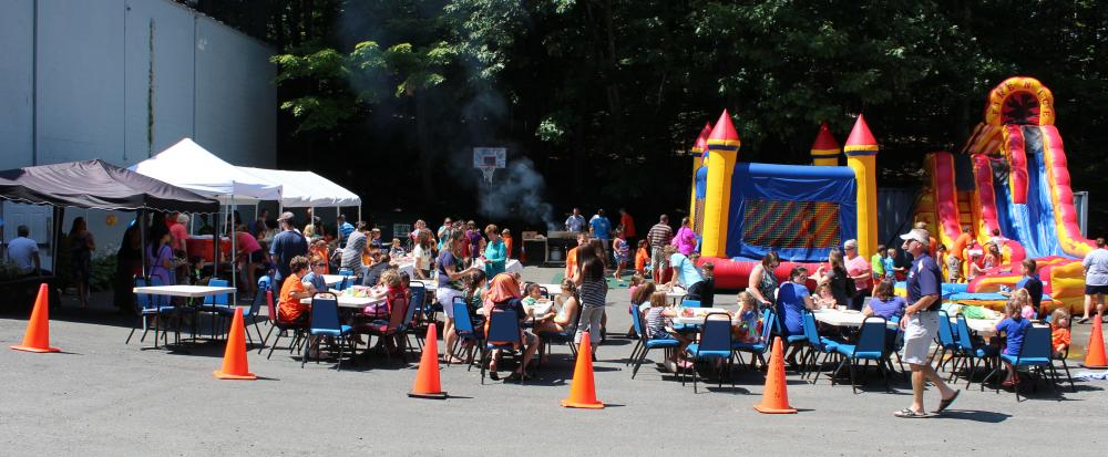 The fun side of religious education: families and Vacation Bible School (VBS) volunteers celebrated the end of VBS at Grace Family Church, on August 14, with an outdoor picnic and activities.