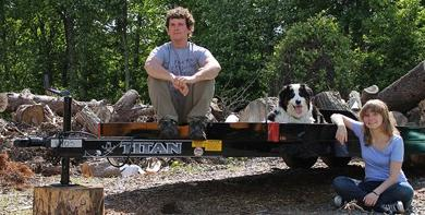 """Luise and Shawn Gleason with Sophie, their """"punk dog"""" Australian shepherd, with the trailer that will serve as the base for their tiny house. The small dwelling will eventually allow the couple to move around the country, and the world,…"""