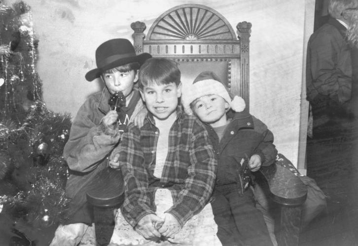 """Falling from a folder marked """"For use in the 1996 X-mas Supplement,"""" a photo showing these three boys doesn't include their names. Contact Kendra Bobowick at <i>The Newtown Bee</i> if you recognize any of these young men.  (Bee file photo)"""