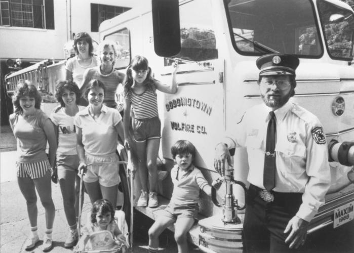 """Written on the back of this photo is only the note: """"Dodgingtown Fun Walk Planned."""" The photo contains no names or dates, but that's clearly a Dodgingtown Volunteer Fire Company truck, with a marker plate identifying the vehicle as a Maxim 1968, and…"""