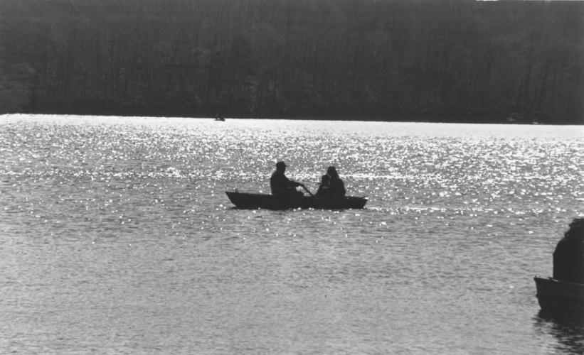 """A 1984 file photo marked only as """"sports"""" shows what appears to be a man rowing a boat with a woman and child as passengers. The location is not identified. Any guesses from our readers?  (Bee file photo)"""