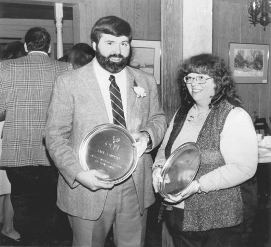 """Jack Shpunt and Marion Mead hold their OCN plaques engraved with the Newtown rooster. The writing says, """"Outstanding Citizen of Newtown."""" No date is provided, but just above Mr Shpunt's thumb is what appears to be 1982. -Bee file photo"""
