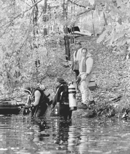 """""""Area dive teams plunge into training"""" is the handwritten note on the back of this image. No other information is available, other than it came from a folder containing other images from the early 1990s."""