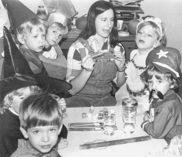 Although the children here are dressed in costumes, it is unclear if this is an image from a past Halloween event. The only information written on the back of this photo is a date: 1984.