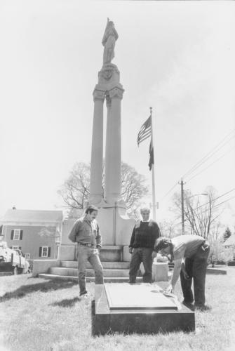 This photo of the monument on the corner of School House Hill Road and Main Street ran in <i>The Newtown Bee </i>in the early 1980s. Does anyone recognize any of these three men, or remember what they were working on when this photo was snapped?  …