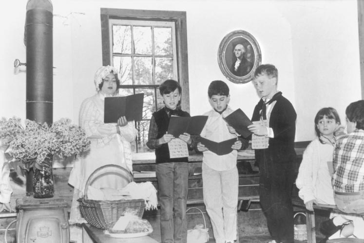 """An old photo found in a folder at The Bee dated May 26, 1995, says only: """"Middle Gate 1 room schoolhouse."""" Does anyone recognize anyone in this photo, or remember what might have been happening when it was taken?"""