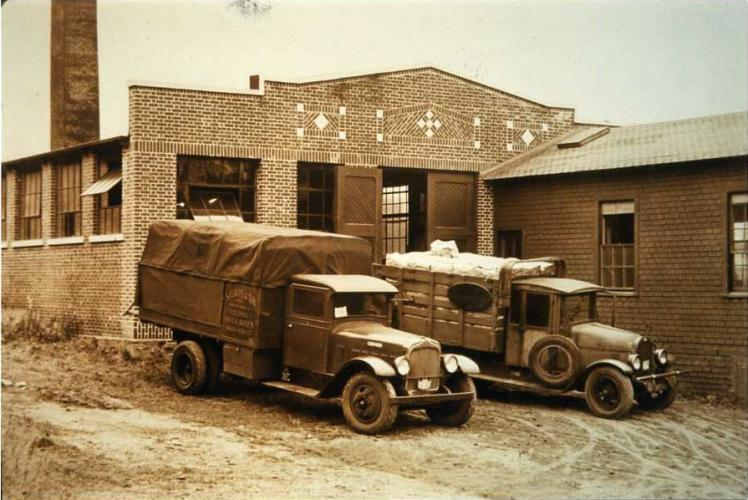 Curtis & Sons trucks sit outside a warehouse circa 1930s. Town Historian Dan Cruson believes the Newtown Historical Society photo reveals a brick building in the same location as today's company off of Berkshire Road just past Toddy Hill Road.