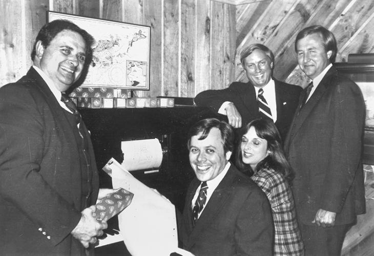 Dated for October 29, '82, this Newtown Bee file photo identifies only Chuck Pilchard, left, Democratic Town Committee. Does anyone recognize anyone else in the photo, or the background of where they were gathered?
