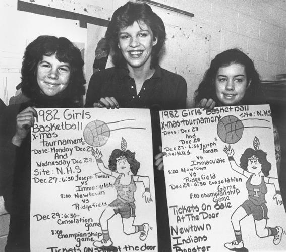 Clearly promoting the 1982 girls basketball tournament are these three young ladies. The back of this photo contains no additional information.