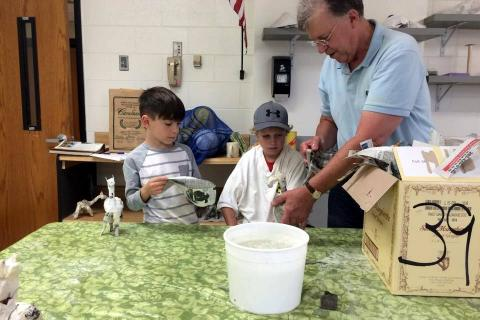 From left, Newtown Parks and Recreation's Drawing and Mixed Media campers Rafe D'Agostino and Jimmy Ballard watch as instructor Chuck Fulkerson demonstrated papier mâché techniques on Wednesday, July 15.