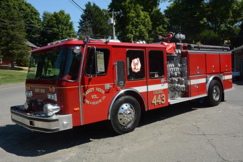 Sandy Hook Volunteer Fire & Rescue Company's Engine 443 is shown parked along Riverside Road near the company's main firehouse, after having been put into service for firefighting.