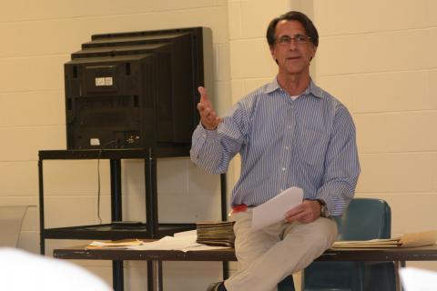 Mark R. Baus, a local equine veterinarian, volunteers as a teacher for inmates at Garner.