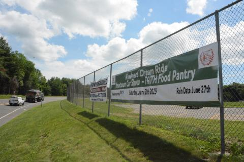 On Wednesday, June 17, these two banners were on display on a chain link fence along the eastbound side of Wasserman Way at Fairfield Hills in the area where Danbury Hall formerly stood. The town recently stopped displaying such banners above Queen…