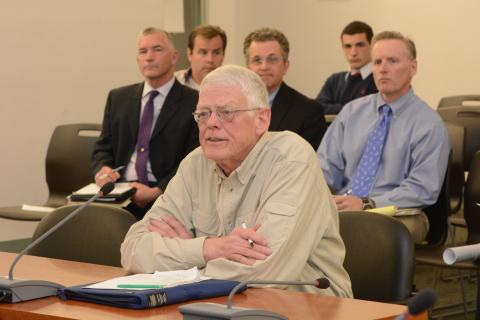 Joseph Hovious, representing the Candlewood Valley Chapter of Trout Unlimited, a private environmental protection group, raised some questions about the potential environmental effects of a 74-unit housing complex proposed for Sandy Hook Center,…