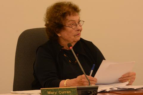 Inland Wetlands Commission Chairman Mary Curran listens to a comment on May 27 at the IWC's third public hearing on a proposal to build 74 condominium units on Washington Avenue in Sandy Hook Center. The IWC granted a wetlands/watercourses…