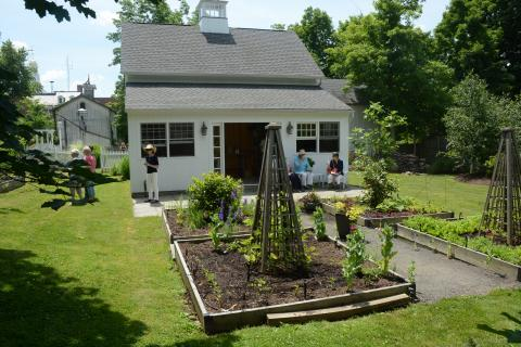 Well-organized gardens are situated next to a garage/utility building in the rear yard at 53 Main Street, behind the early 19th Century Boyle-Poirier residence.