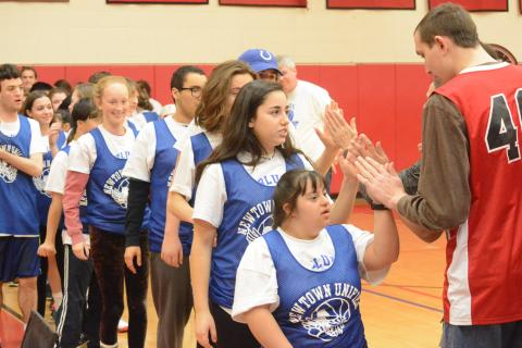 Members of the Newtown High Blue Blaze Unified Sports basketball team shake hands with opponents from Masuk after a game. (Bee Photo, Hutchison)