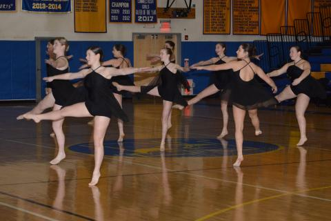 Newtown High's dance team performs at halftime of a basketball game this winter. The squad went on to earn a state title on February 24. (Bee Photo, Hutchison)