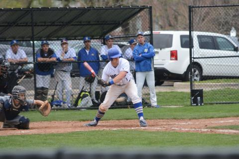 Sam Czel checks his swing on a pitch during Newtown's game against Weston on April 28. (Bee Photo, Hutchison)
