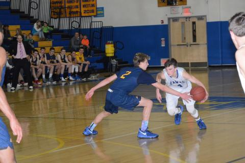 Tucker Garrity dribbles the ball during Newtown's loss to Weston. (Bee Photo, Hutchison)