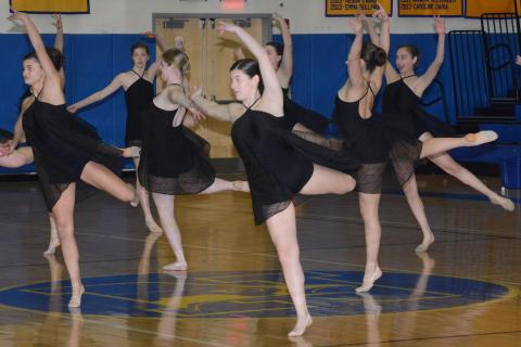 Newtown High's dance team performs during halftime of a basketball game at NHS this winter. The girls went on to place second in the SWC championship. (Bee Photo, Hutchison)