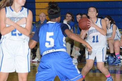 Natalie Shaker lines up a shot at the basket as Greta Staubly gets into position and a Bunnell player defends. (Bee Photo, Hutchison)