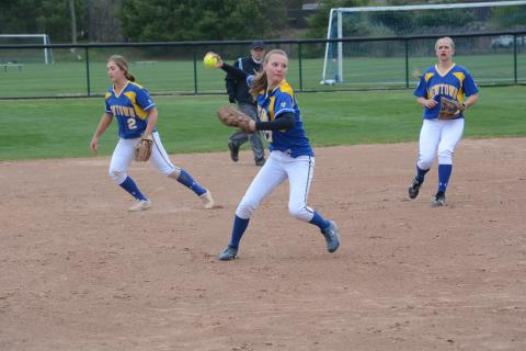 Pitcher Lauren Wilcox throws to first as infielders Katie Laaksonen, left, and Mail Klorczyk get into position. (Bee Photo, Hutchison)