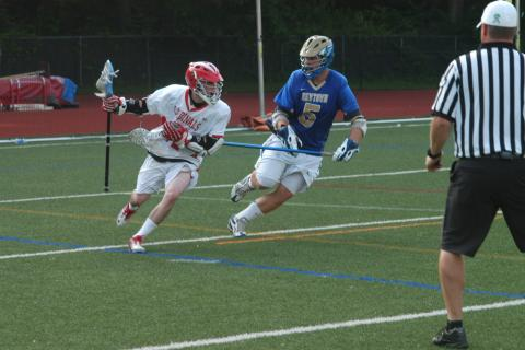 Newtown's Cam Partrick, right, defends a Greenwich player during a loss in the state tournament's first round on May 29.