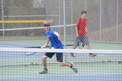Joey Conrod hits a return during a match at the high school.