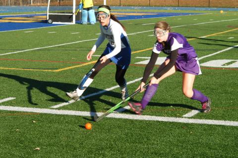 Erica Thill, left, races after the ball while a Westhill player keeps it in play during state tourney action at Blue & Gold Stadium on November 4. Westhill prevailed 1-0.