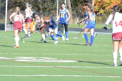 Megan Kelleher defends a Bethel player as teammates Katie Cappelli (No. 35) and Jaimy Fellin (No. 24) stand in position, during Newtown's 1-0 double overtime conference tourney playoff loss, in Danbury, on October 31.