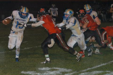 Nick Lotrecchiano looks for running room during Newtown's win at Masuk. Lotrecchiano scored a touchdown in the triumph.
