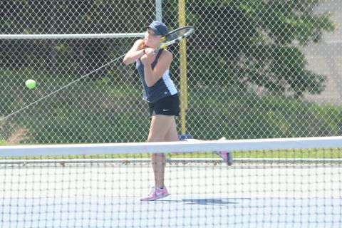 Lauren Beier hits a return during her opening-round win over Simsbury, at Newtown High, on May 30.