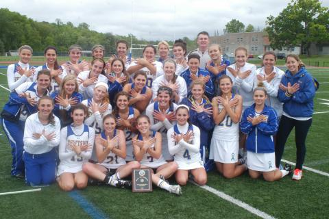 Newtown High School's girls' lacrosse team celebrates its ninth straight South-West Conference championship after defeating Brookfield 13-6 on May 24.