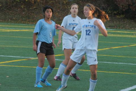 Marissa Thill heads the ball during Newtown's win over Kolbe Cathedral on October 21.