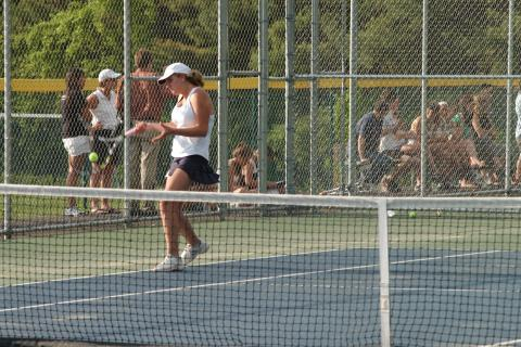 Grace Winans hits a return during postseason action. The Newtown High doubles player helped the Nighthawks earn SWC individual tourney championships at every position in the singles and doubles brackets.