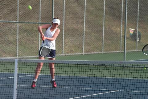 Lily Mittleman hits a return during Newtown's match against Weston on April 28.