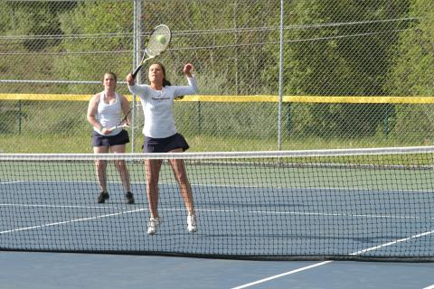 Stephanie Roman hits a return as doubles partner Julia Frattaroli looks on. The top doubles team will try to help the Hawks to their second straight SWC title on May 20.