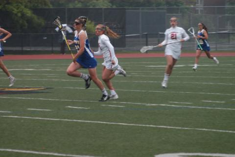Meaghan Brophy runs with the ball during Newtown's state tourney game loss at Greenwich.