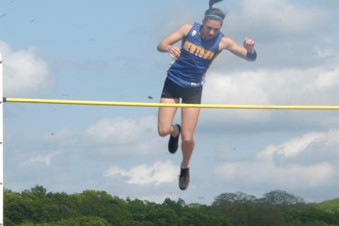Jenna Calandro pole vaults to a second-place finish in the SWC championships in Bethel on May 20.