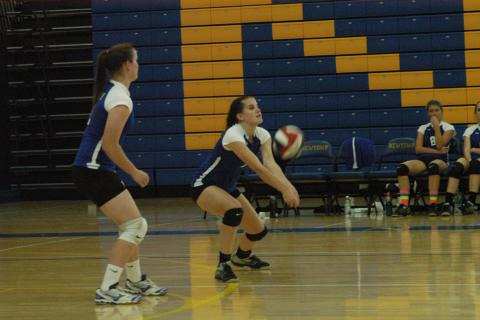 Mylis Post keeps the ball in play during SWC tourney action. The Nighthawks reached the championship match with wins over Brookfield and Bunnell.