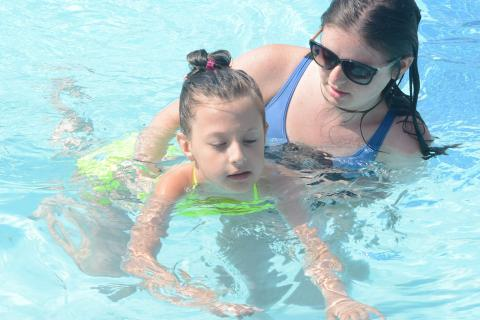Up and coming swimmer Lilian Ismail gets pointers from Natalie Barden. (Bee Photo, Hutchison)