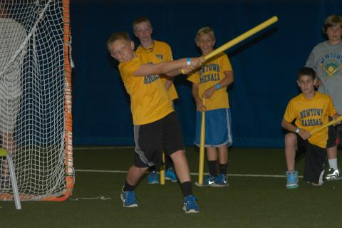 Young Wiffle Ball enthusiasts took swings at the ball to assist Ed Randall's efforts in taking swings agaisnt prostate cancer during the tourney at NYA.