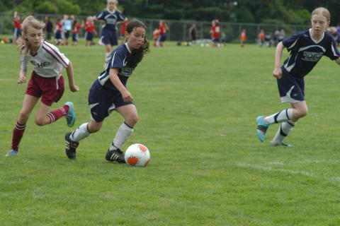 Youth soccer players compete during a game in town this past spring. The Recreation Commission is making changes to ensure equal opportunity for all Newtown youth athletes to use fields for athletics.