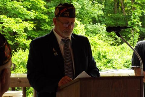 VFW Post 308 Commander Jim Lewis invited veterans that were present during Monday's ceremony to stand to be recognized.  (Bee Photo, Silber)