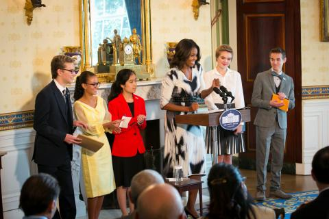 First Lady Michelle Obama, third from right, hosted a poetry reading in honor of the 2014 National Student Poets in the Blue Room of the White House, September 18, 2014. The National Student Poets, from left, are Cameron Messinides, Madeleine…