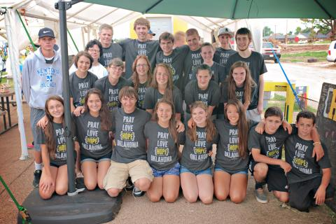 The group of young adults and chaperones who traveled from Newtown to Moore, Okla., July 21-26, included, front row: Marissa Thill, Erica Thill, Mergim Bajraliu, Tess Murray, Maggie Kost, Alana Murray, Matt Gonzalez, and Joe Fiorella; second row:…