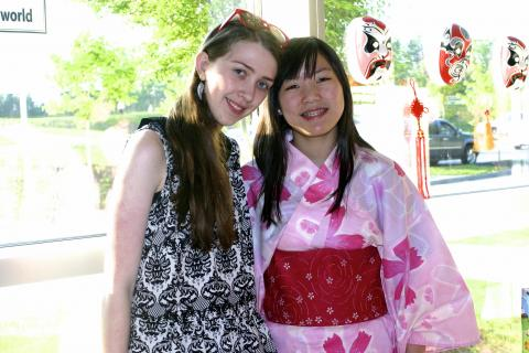 Newtown High School juniors Lee Cummings, left, and Emily Berube both hosted Japanese students in March. They are pictured during the May 15 highlight night held for the Newtown International Center for Education (NICE).    &nbsp…
